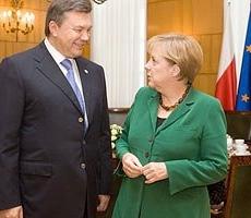 Ангела Меркель и Виктор Янукович встретились в Вильнюсе
