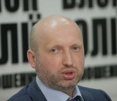 Срочно: снайпер ранил Турчинова на сцене Майдана