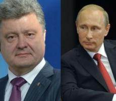 Владимир Путин и Петр Порошенко обсудили ситуацию на Донбассе