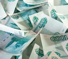 Рубль продолжит падение следом за дешевеющей нефтью